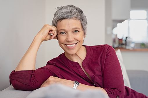 A mature woman smiling after botox treatment from Advanced Family Dentistry
