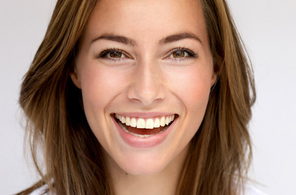 Woman smiling with straight white teeth after cosmetic dental services from David R. Stagge, DDS in Muncie